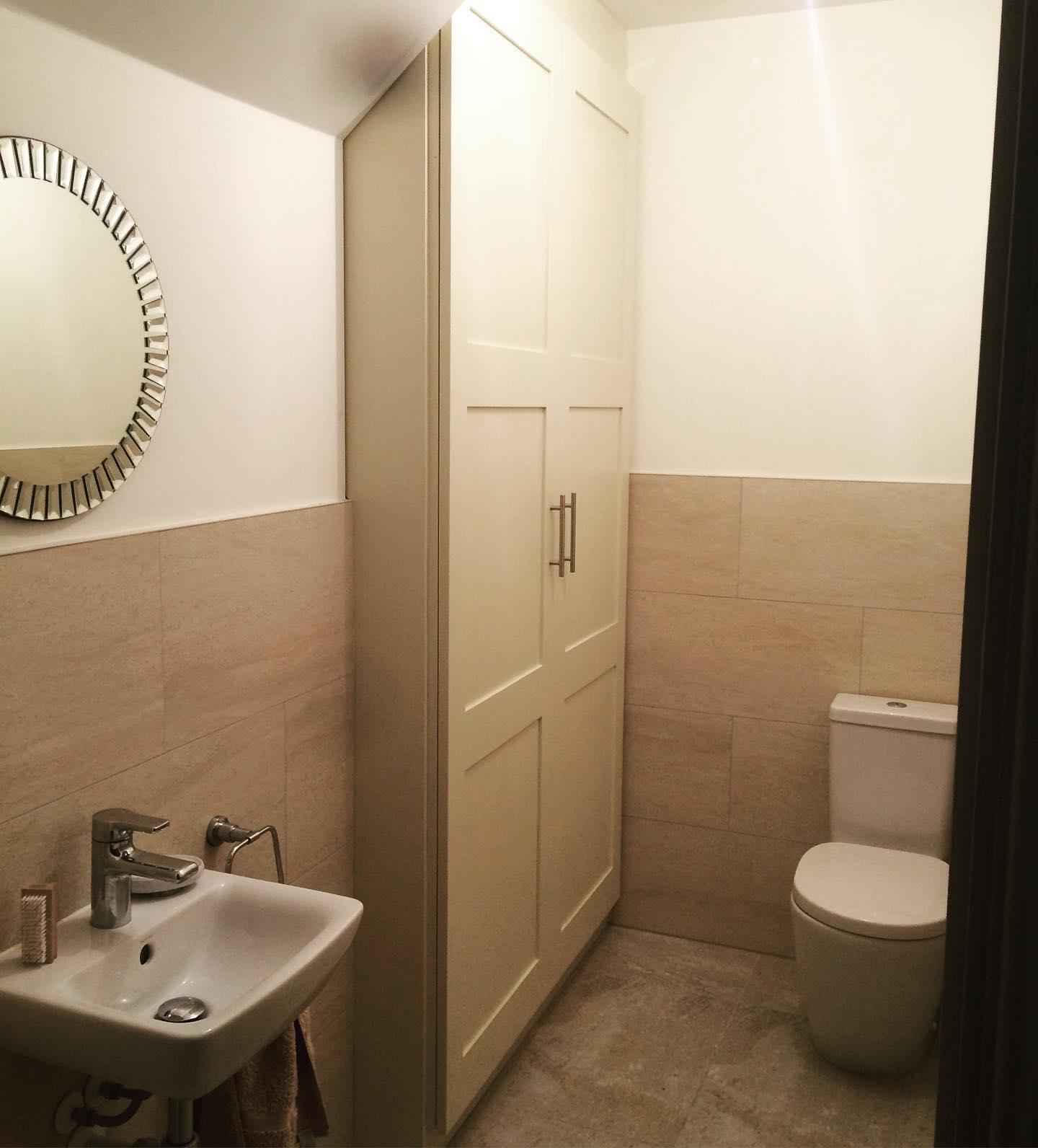 Fitted bathroom storage cupboard